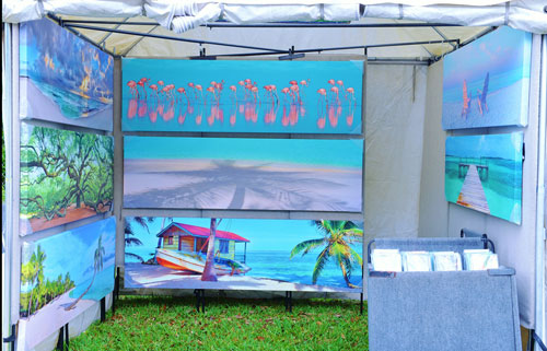 art show booth displaying photography on canvas prints