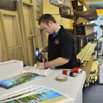 Workers assembling gallery wraps of custom canvas photos